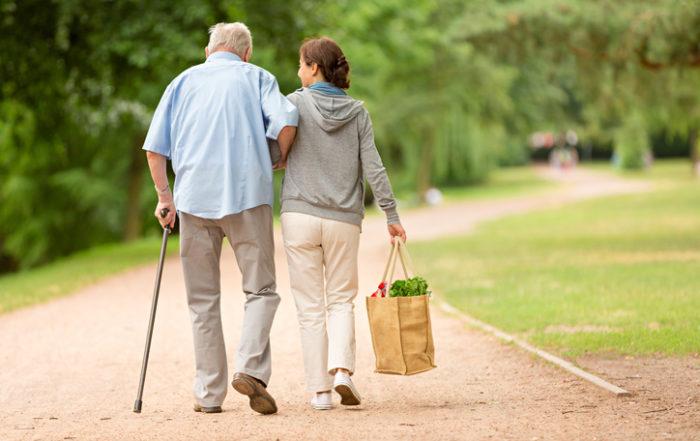 Daughter caregiving for elderly father